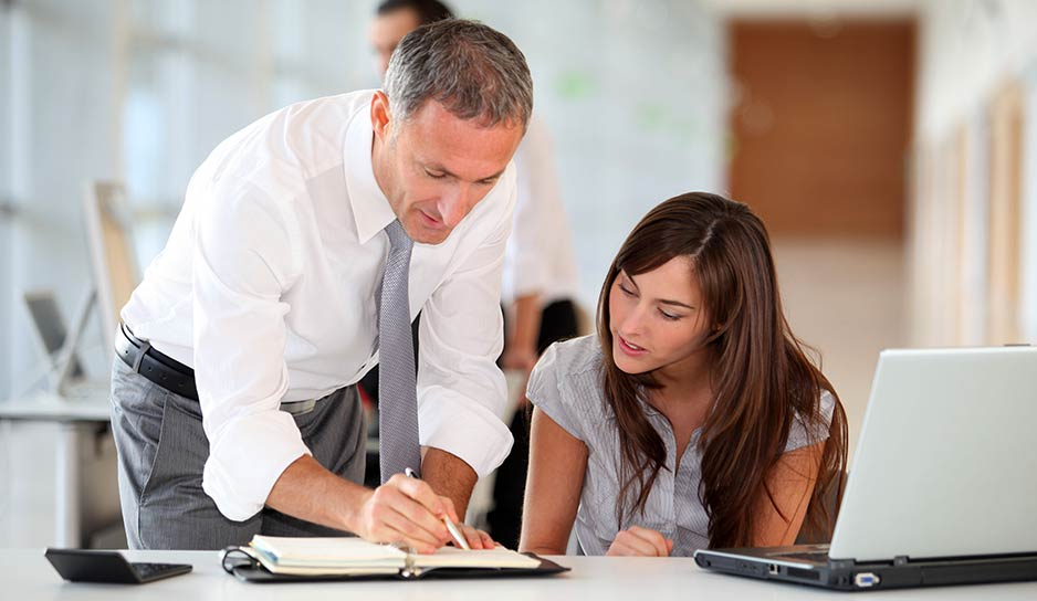 leader helping employee